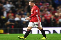 Rooney defended after drinking apology