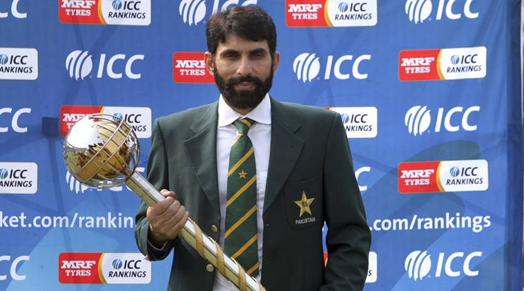 Pakistan's skipper of Test cricket team Misbah-ul-Haq holds test mace handed over by International Cricket Council (ICC) chief executive David Richardson during a ceremony at Gaddafi Stadium in Lahore, Pakistan, Wednesday, Sept. 21, 2016. Misbah-ul-Haq says it's a big achievement to lead Pakistan to No. 1 in test rankings, given the team has not played on home soil for seven years. (AP Photo/K.M. Chaudary)