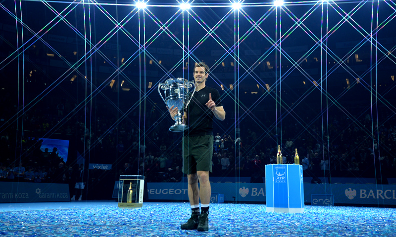 This file photo taken on November 20, 2016 shows Britain's Andy Murray posing with the ATP World Number One trophy after winning the men's singles final against Serbia's Novak Djokovic on the eighth and final day of the ATP World Tour Finals tennis tournament in London.