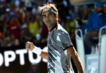 Federer wobbles but roars back to reach third round