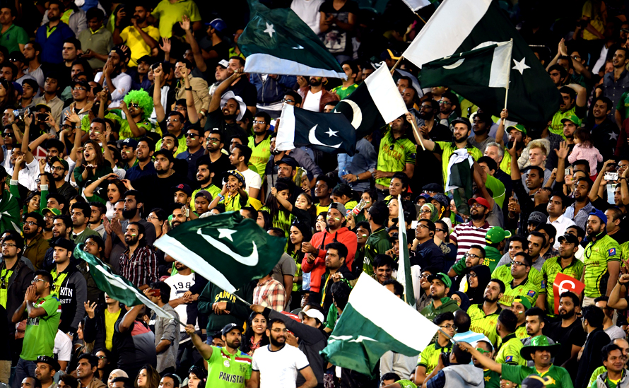 Pakistan fans cheer for their team. (PHOTO: AFP)
