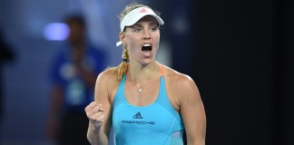 Top seed Kerber battles into second round