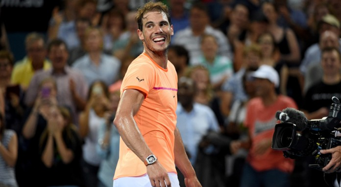 Nadal cruises, net-focused Raonic slugs it out in Brisbane