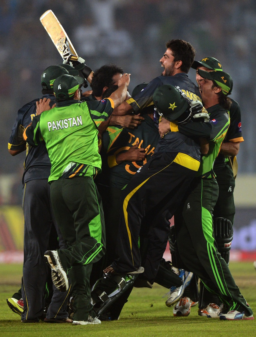 Pakistan cricketers react after winning the sixth match of the Asia Cup one-day cricket tournament between India and Pakistan at the Sher-e-Bangla National Cricket Stadium in Dhaka on March 2, 2014. AFP PHOTO/Munir uz ZAMAN (Photo credit should read MUNIR UZ ZAMAN/AFP/Getty Images)