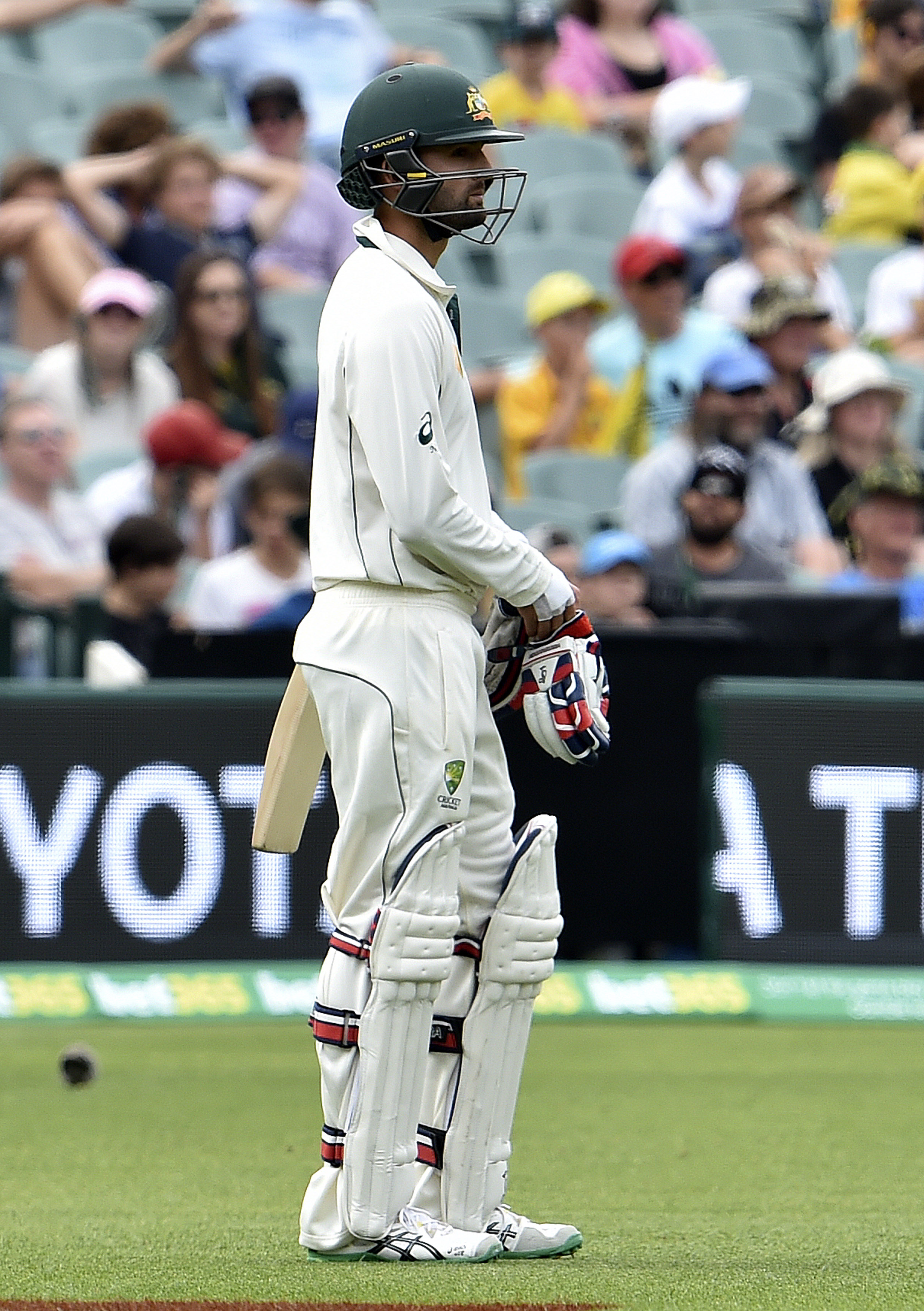 This photo taken on November 28, 2015 show Australia's batsman Nathan Lyon waiting for the decision by TV umpire Nigel Llong at the boundary line during first day-night cricket Test match against New Zealand at the Adelaide Oval. New Zealand have contacted the International Cricket Council seeking answers over a contentious review that went against them at a crucial time in the fluctuating day-night Test against Australia, coach Mike Hesson said on November 30.  AFP PHOTO / SAEED KHAN IMAGE RESTRICTED TO EDITORIAL USE - NO COMMERCIAL USE / AFP / SAEED KHAN