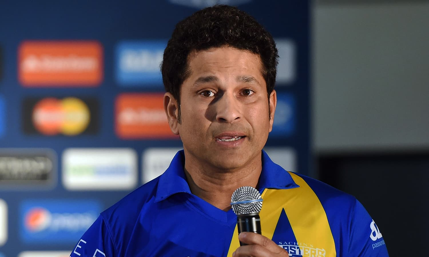 "Retired Indian cricketer Sachin Tendulkar speaks during a press conference in New York on November 5, 2015. Tendulkar and Australia's Shane Warne will lead a lineup of renowned cricket players from around the world in the inaugural ""Cricket All-Stars,"" a three-game series to be played in Major League Baseball stadiums in New York , Houston and Los Angeles, to promote cricket the US. AFP PHOTO/JEWEL SAMAD"