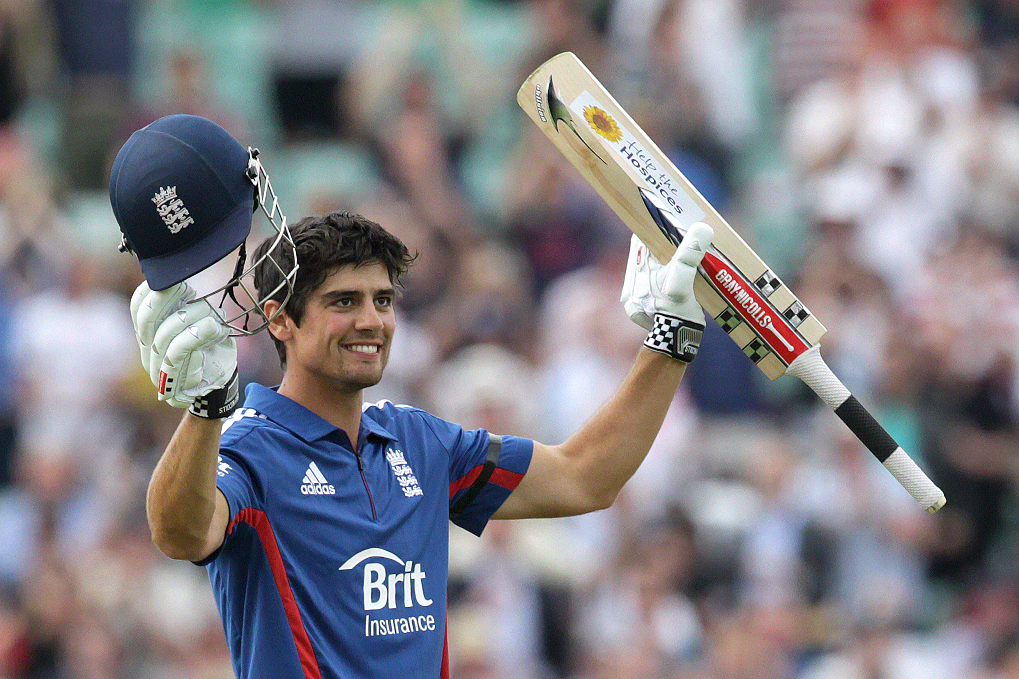 Alastair Cook of England celebrates after he reaches his century during the second one-day international (ODI) cricket match between England and the West Indies at the Oval in London on June 19, 2012. AFP PHOTO / RICHARD WASHBROOKE  -   RESTRICTED TO EDITORIAL USE. NO ASSOCIATION WITH DIRECT COMPETITOR OF SPONSOR, PARTNER, OR SUPPLIER OF THE ECB        (Photo credit should read RICHARD WASHBROOKE/AFP/GettyImages)
