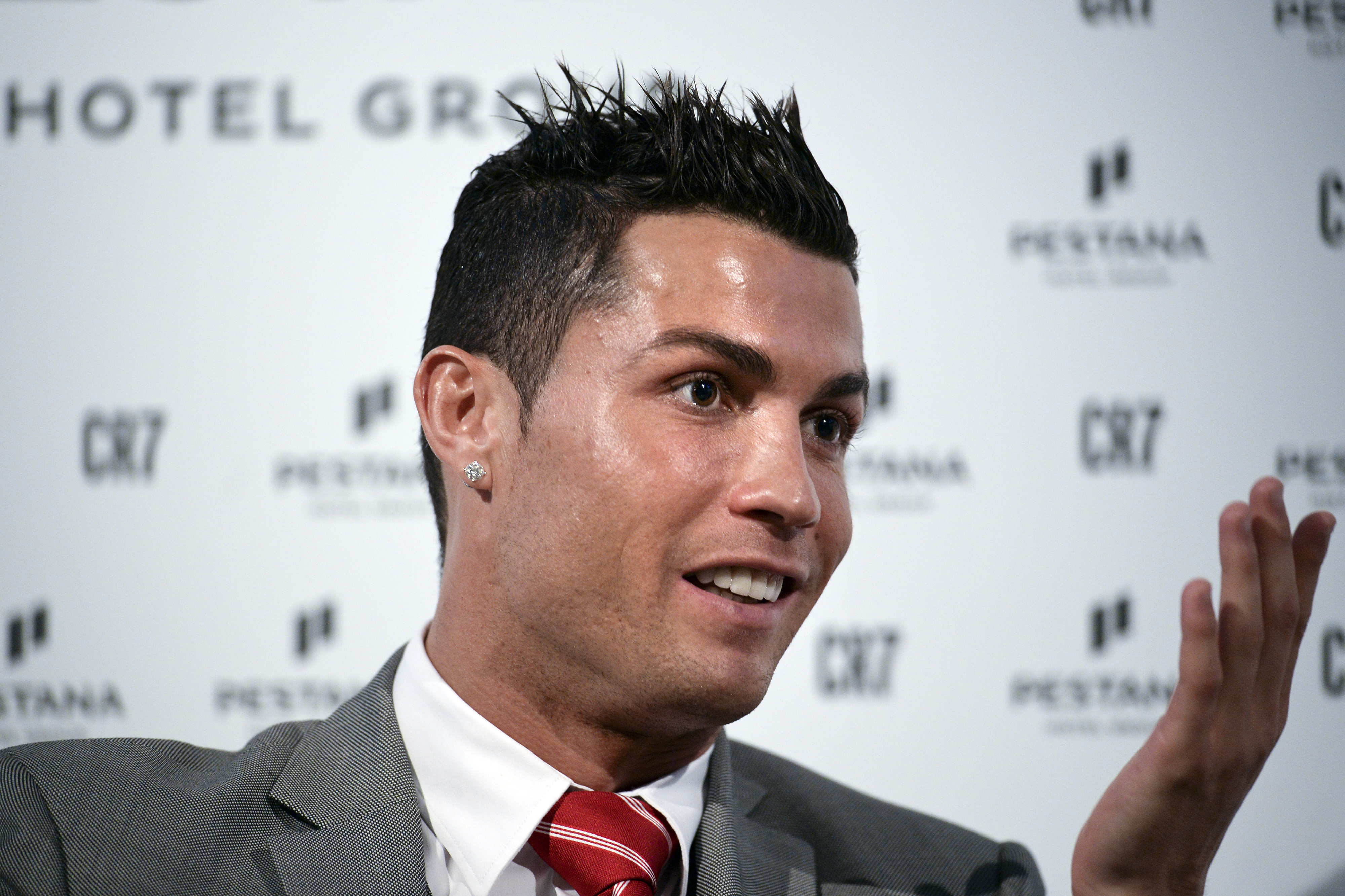 "Real Madrid's player Cristiano Ronaldo speaks during a press conference at Pestana Hotel Palace in Lisbon on December 17, 2015. Cristiano Ronaldo will invest over 37 million euros in the Pestana hotel group to create four new hotels with the ""CR7"" logo in Portugal, Madrid and New York.   AFP PHOTO / PATRICIA DE MELO MOREIRA / AFP / PATRICIA DE MELO MOREIRA"