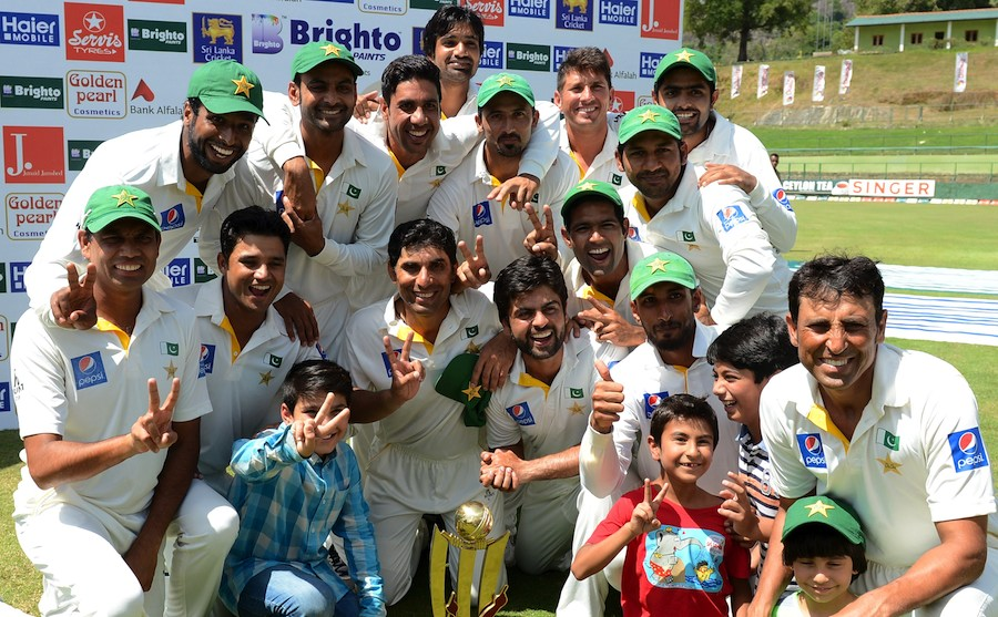 Pakistan cricketers pose after their team's series victory following the third and final Test cricket match between Sri Lanka and Pakistan at The Pallekele International Cricket Stadium in Pallekele on July 7, 2015. AFP PHOTO / LAKRUWAN WANNIARACHCHI (Photo credit should read LAKRUWAN WANNIARACHCHI/AFP/Getty Images)