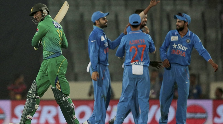 Dhaka : Pakistan's Shoaib Malik, left, walks back to the pavilion after his dismissal by India's Hardik Pandya, second right, during the Asia Cup Twenty20 international cricket match between them in Dhaka, Bangladesh, Saturday, Feb. 27, 2016. AP/PTI(AP2_27_2016_000170B)