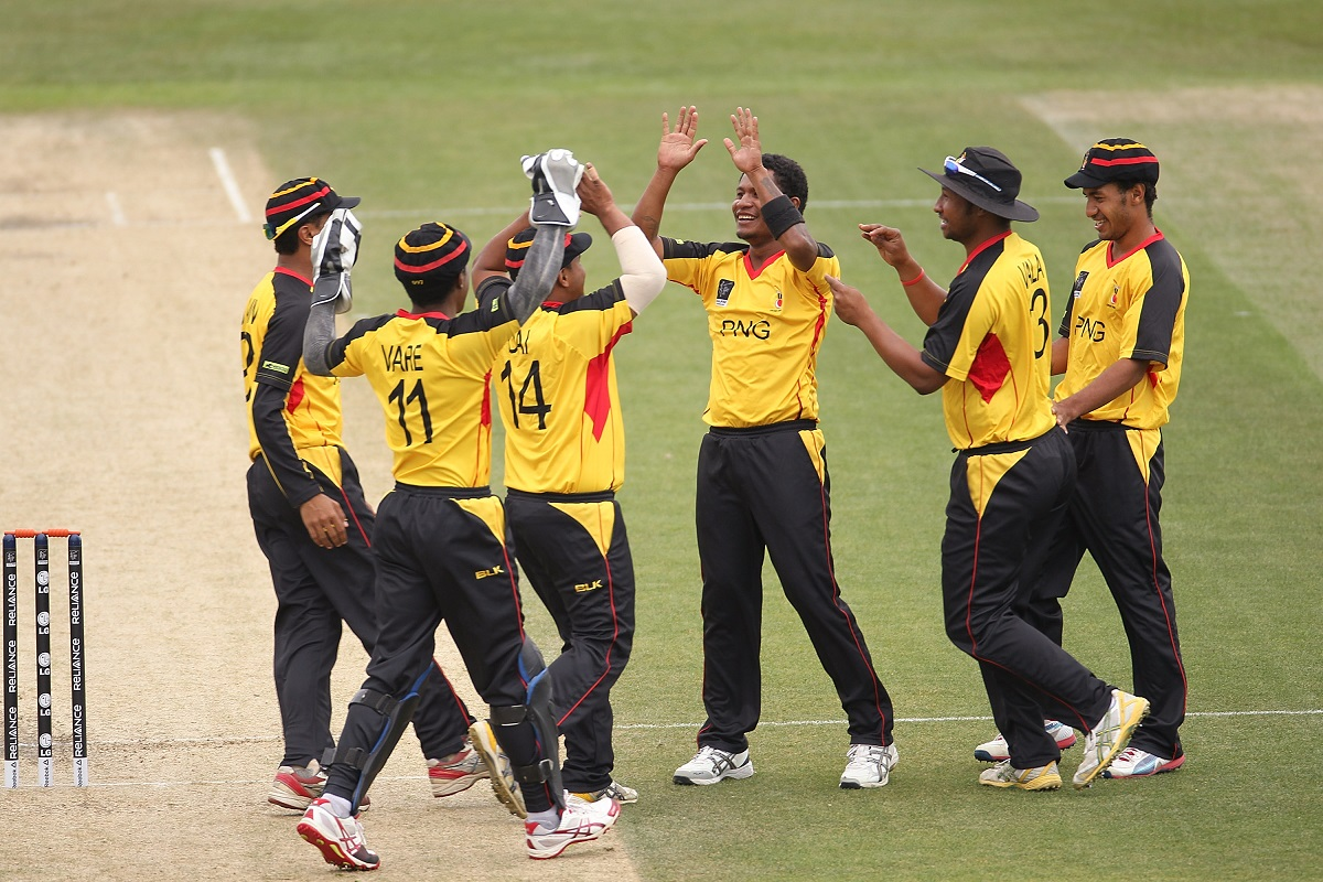 CHRISTCHURCH, NEW ZEALAND - JANUARY 26: Pipi Raho (3R) of PNG celebrates with team mates after the wicket of Salman Faris of UAE during the ICC Cricket World Cup Qualifier match between UAE and PNG at Hagley Oval on January 26, 2014 in Christchurch, New Zealand. (Photo by Martin Hunter-IDI/IDI via Getty Images)