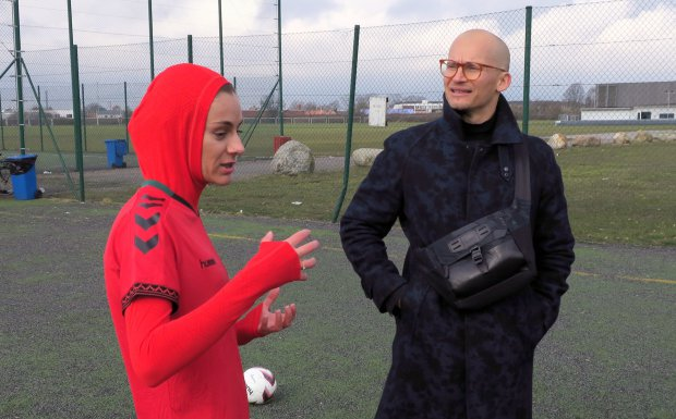 Afghani national soccer team player Shabnam Mabarz, left, wearing the new head-to-toe outfit with an integrated hijab, talks with Hummel CEO Christian Stadil in Copenhagen on Tuesday, March 8, 2016. The new Afghanistan national women's soccer team uniform was revealed on Tuesday, featuring an integrated hijab. (AP Photos/Jan M. Olsen)