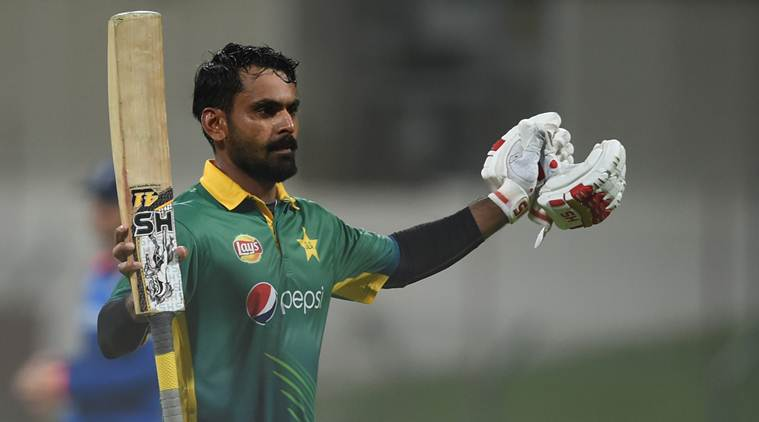 Pakistan's Muhammed Hafeez celebrates scoring a century during the first one day international match against England at Zayed Cricket Stadium in Abu Dhabi, United Arab Emirates, Wednesday, Nov. 11, 2015. (AP Photo/Hafsal Ahmed)