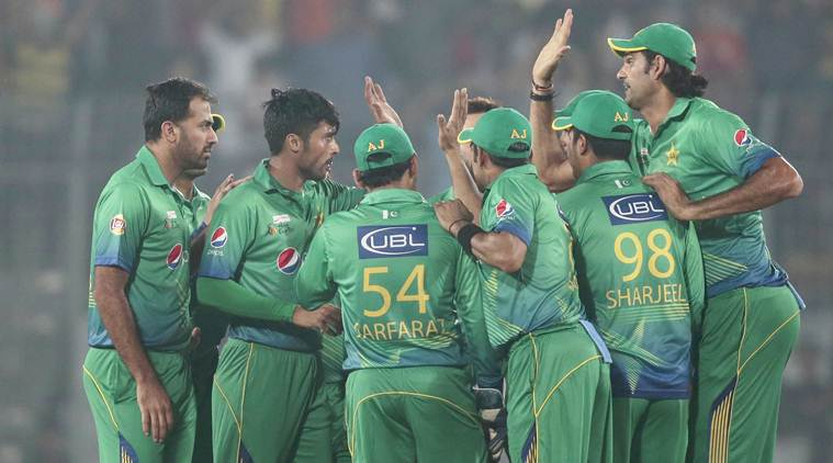 Pakistan's Mohammad Amir, second left, celebrate with his teammates after the dismissal of India's Ajinkya Rahane, during the Asia Cup Twenty20 international cricket match between them in Dhaka, Bangladesh, Saturday, Feb. 27, 2016. (AP Photo/A.M. Ahad)