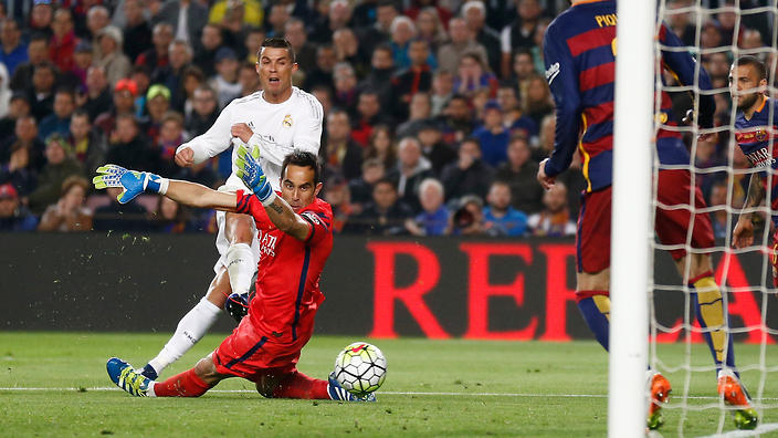 Real Madrid's Cristiano Ronaldo, left, scores his side's second goal past Barcelona goalkeeper Claudio Bravo during a Spanish La Liga soccer match between Barcelona and Real Madrid, dubbed 'el clasico', at the Camp Nou stadium in Barcelona, Spain, Saturday, April 2, 2016. (AP Photo/Manu Fernandez)