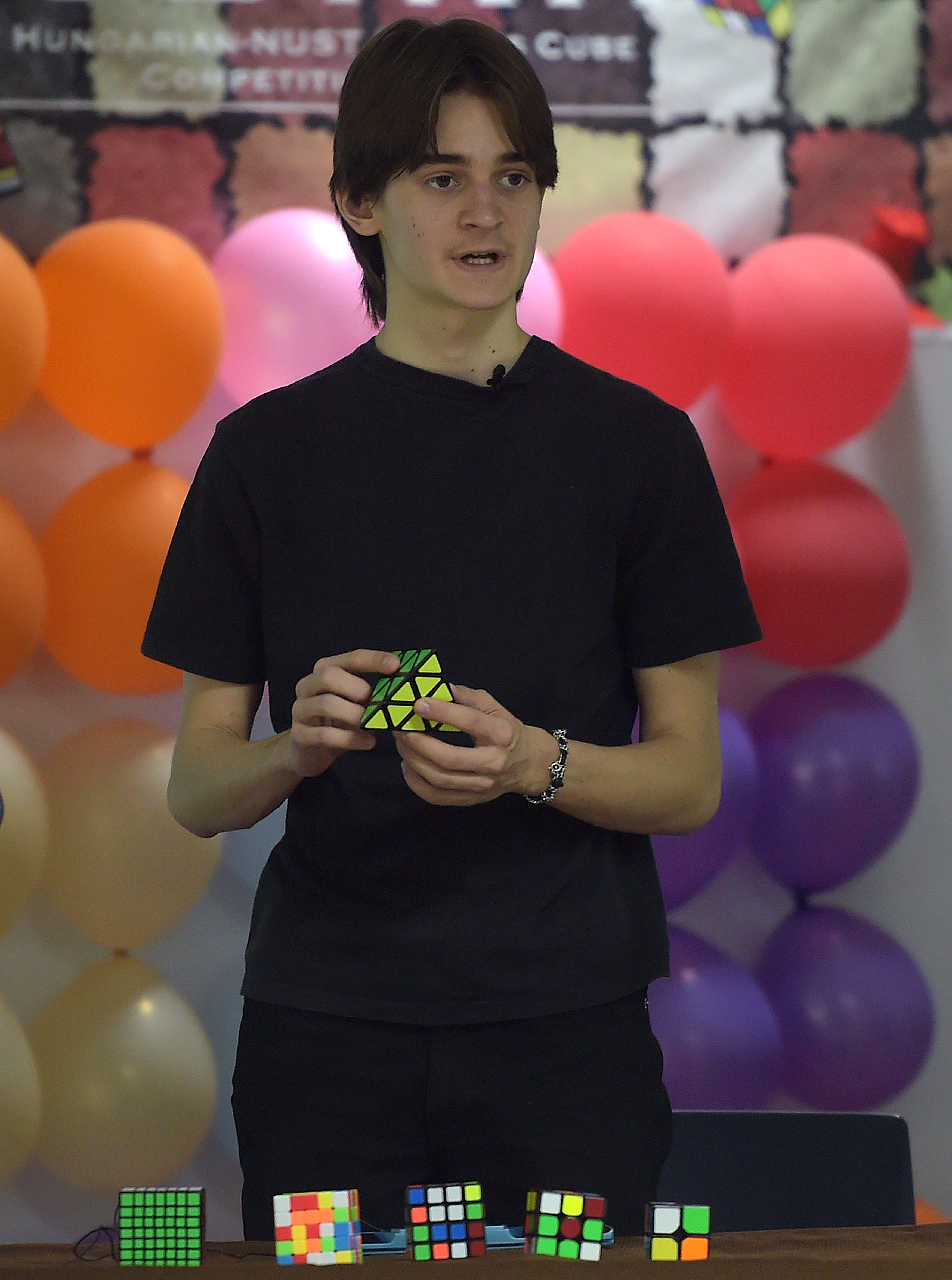 Hunor Bozsing, three times Rubik's Cube Hungarian national champion, demonstrates solving a Rubik's Cube in front of Pakistani students at the National University of Sciences and Technology (NUST) in Islamabad on May 12, 2016. Hunor Bozsing says he got lucky eight years ago: searching for an old toy in his house in Budapest, he instead stumbled across a Rubik's Cube -- a twist of fate which launched him to international fame. Bozsing -- Hungary's three-time national Rubik's Cube champion, who holds six national records -- was in Pakistan on May 12 to organise the country's first Cube competition. / AFP PHOTO / AAMIR QURESHI