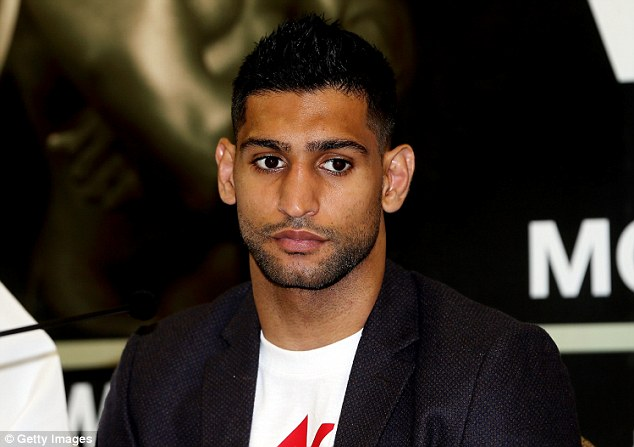 1410439423509_wps_21_Amir_Khan_during_a_Press_