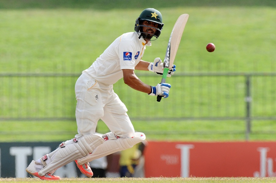 Pakistan cricketer Shan Masood plays a shot during the fourth day of the third and final Test match between Sri Lanka and Pakistan at the Pallekele International Cricket Stadium in Pallekele on July 6, 2015. AFP PHOTO / LAKRUWAN WANNIARACHCHI        (Photo credit should read LAKRUWAN WANNIARACHCHI/AFP/Getty Images)