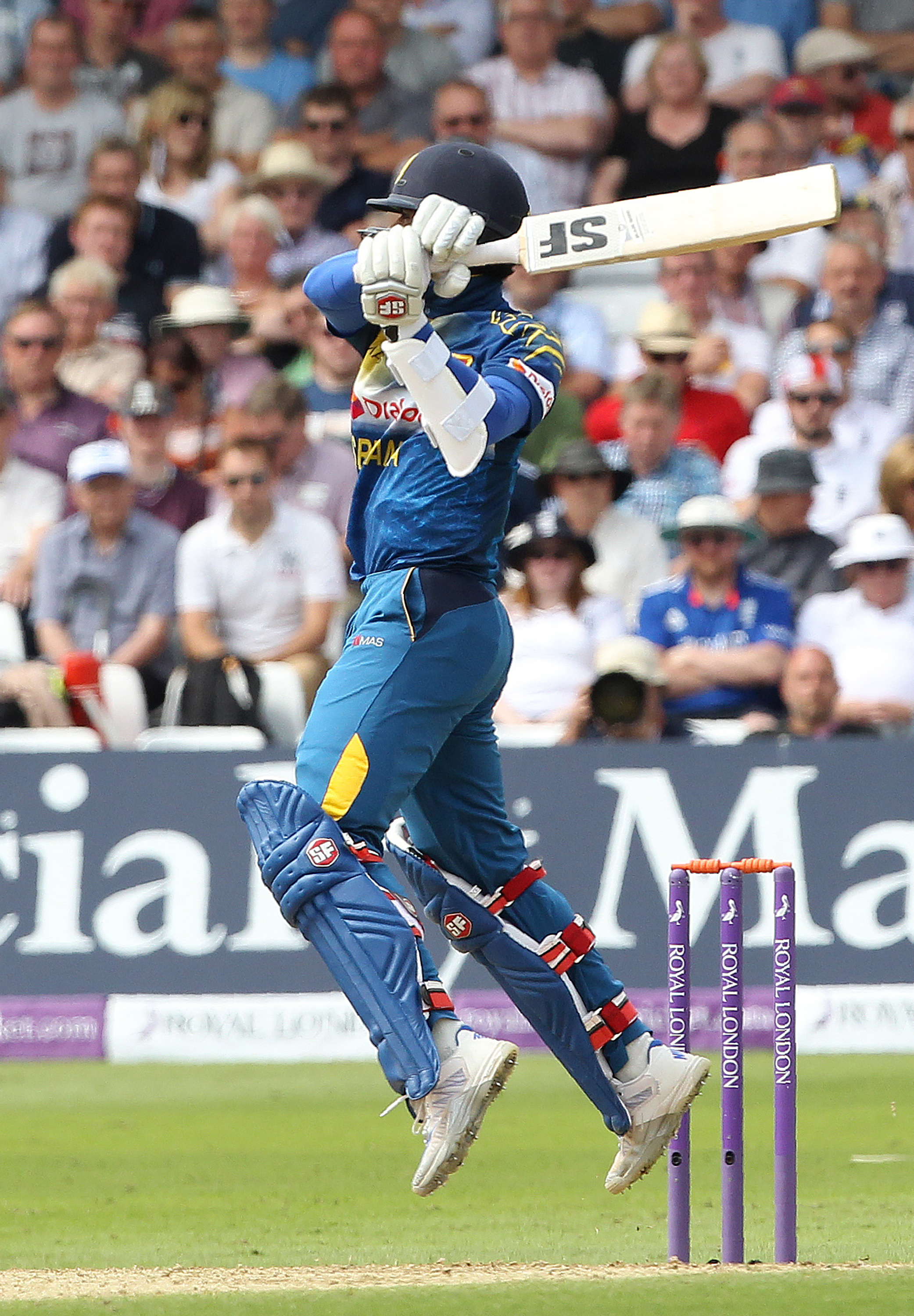 Sri Lanka's Dinesh Chandimal hits a boundary during play in the first one day international (ODI) cricket match between England and Sri Lanka at Trent Bridge cricket ground in Nottingham, central England, on June 21, 2016. England captain Eoin Morgan won the toss and elected to field against Sri Lanka in the first one-day international at Trent Bridge on Tuesday. / AFP PHOTO / Lindsey PARNABY