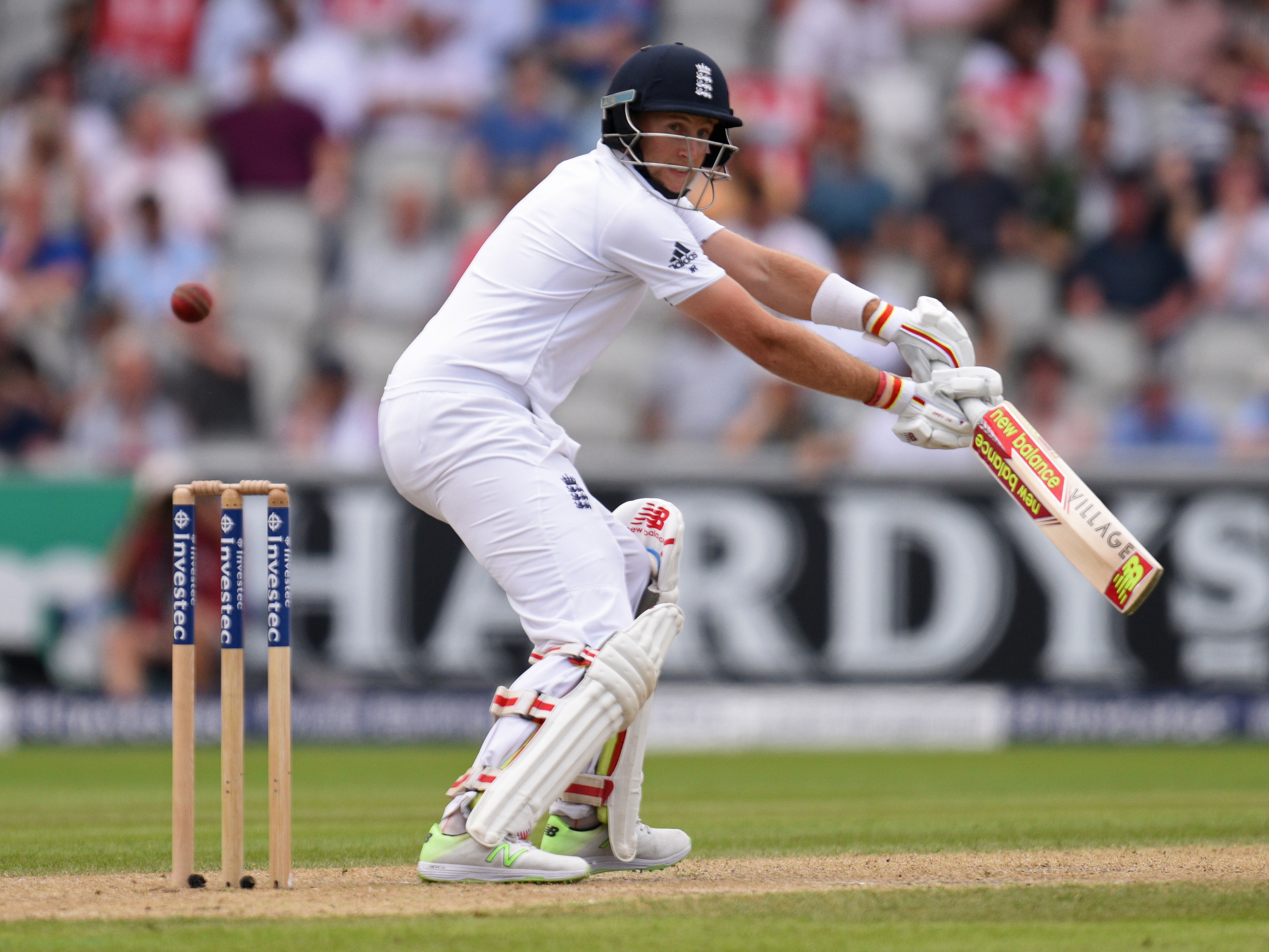 England's Joe Root plays a shot on the second day of the second Test cricket match between England and Pakistan at Old Trafford Cricket Ground in Manchester, England on July 23, 2016. / AFP PHOTO / OLI SCARFF