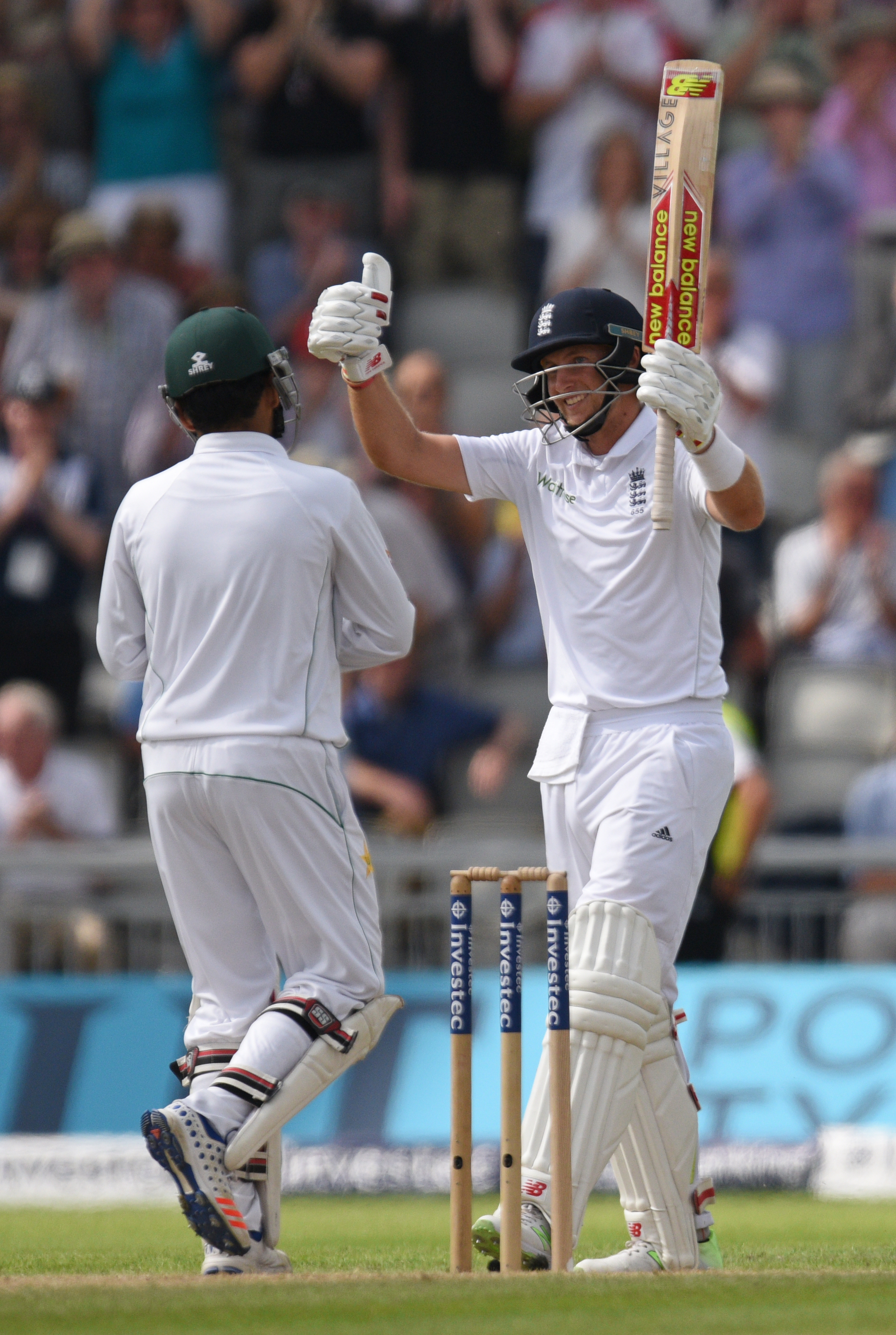 England's Joe Root celebrates reaching 250 on the second day of the second Test cricket match between England and Pakistan at Old Trafford Cricket Ground in Manchester, England on July 23, 2016. / AFP PHOTO / OLI SCARFF