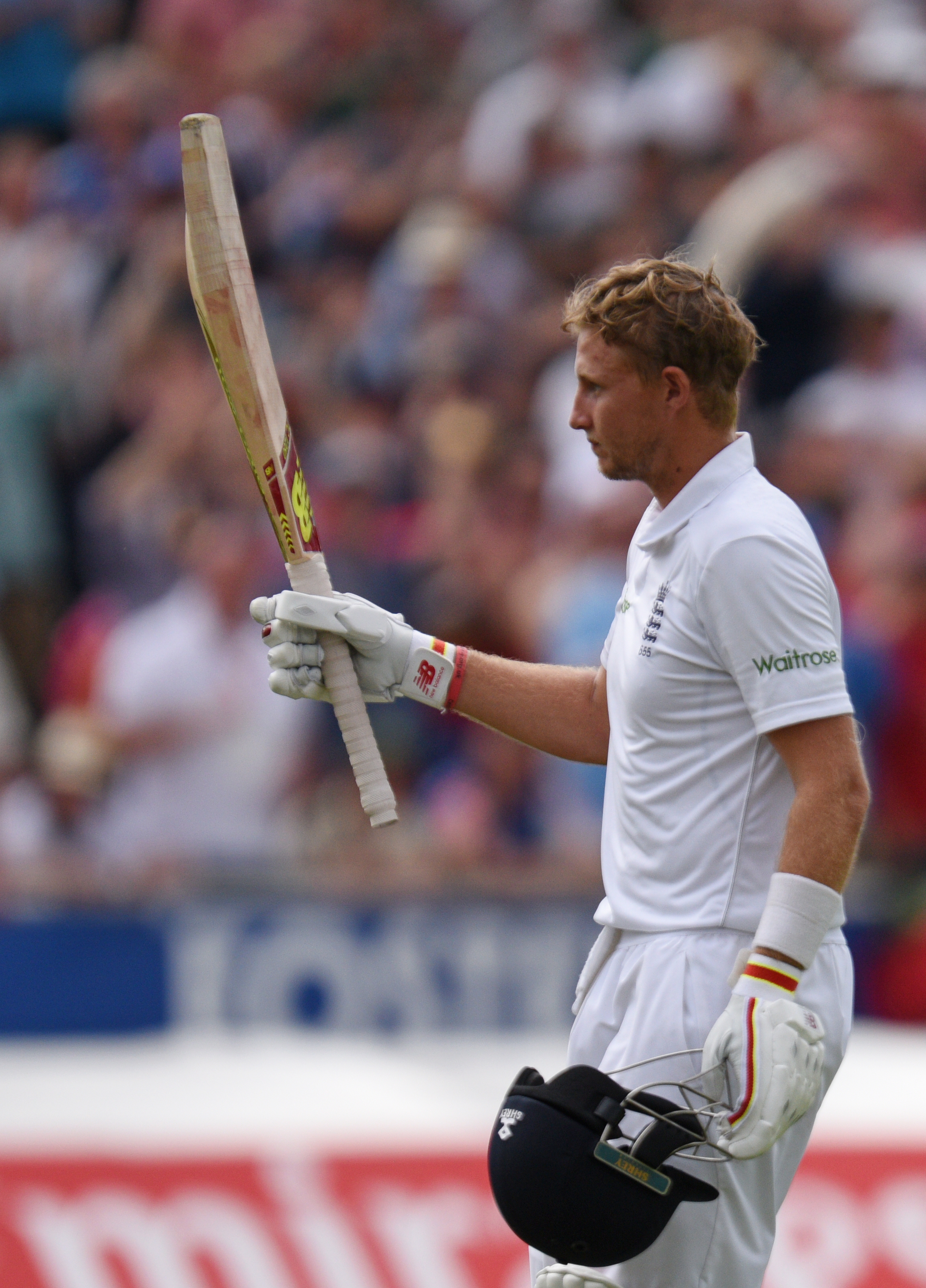 England's Joe Root leaves the pitch after being dismissed for 254 on the second day of the second Test cricket match between England and Pakistan at Old Trafford Cricket Ground in Manchester, England on July 23, 2016. / AFP PHOTO / OLI SCARFF