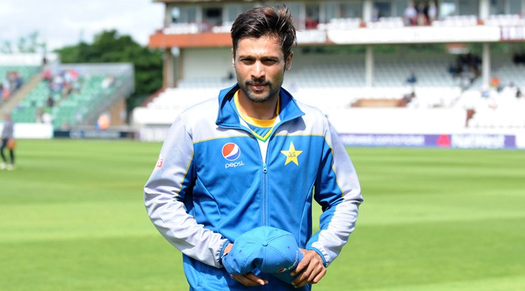 Pakistan's Mohammad Amir walks onto the field to warm up with teammates before day one of the tour match at the County Ground, Taunton, south western England, Sunday July 3, 2016. (Simon Galloway/PA via AP)
