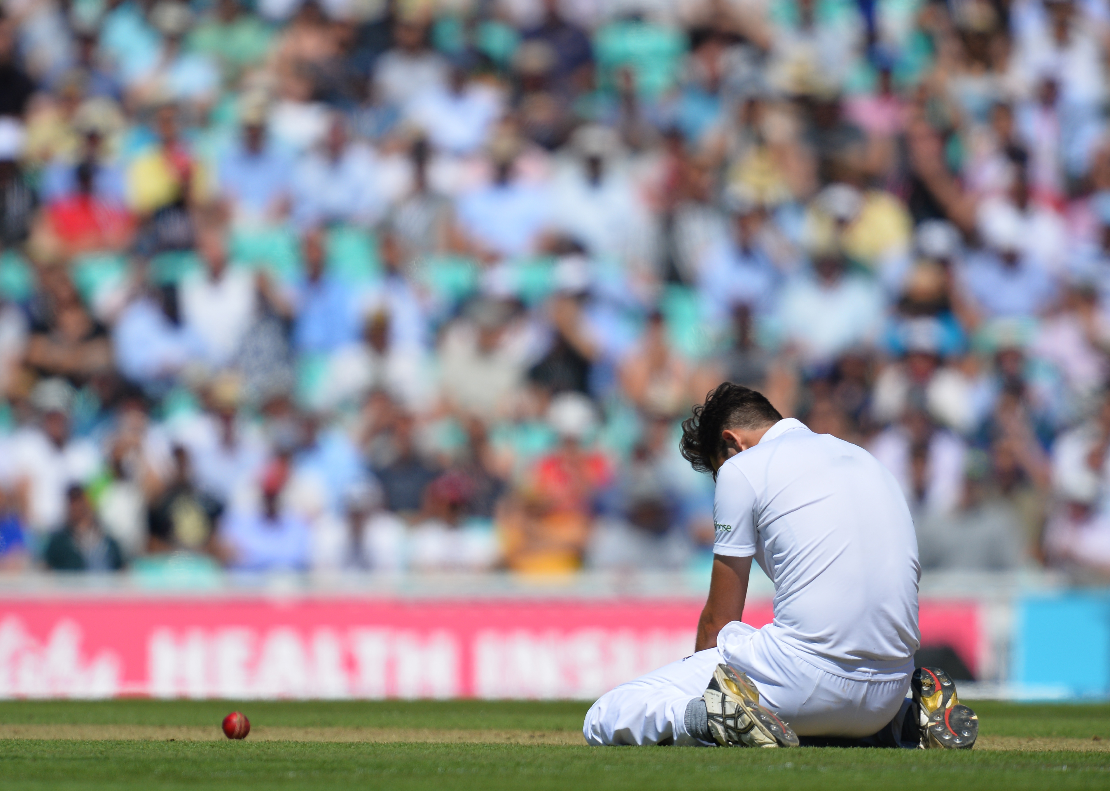 England's Steven Finn reacts after missing a catch off Pakistan's Azhar Ali during play on the second day of the fourth test cricket match between England and Pakistan at the Oval in London on August 12, 2016.   / AFP PHOTO / GLYN KIRK / RESTRICTED TO EDITORIAL USE. NO ASSOCIATION WITH DIRECT COMPETITOR OF SPONSOR, PARTNER, OR SUPPLIER OF THE ECB