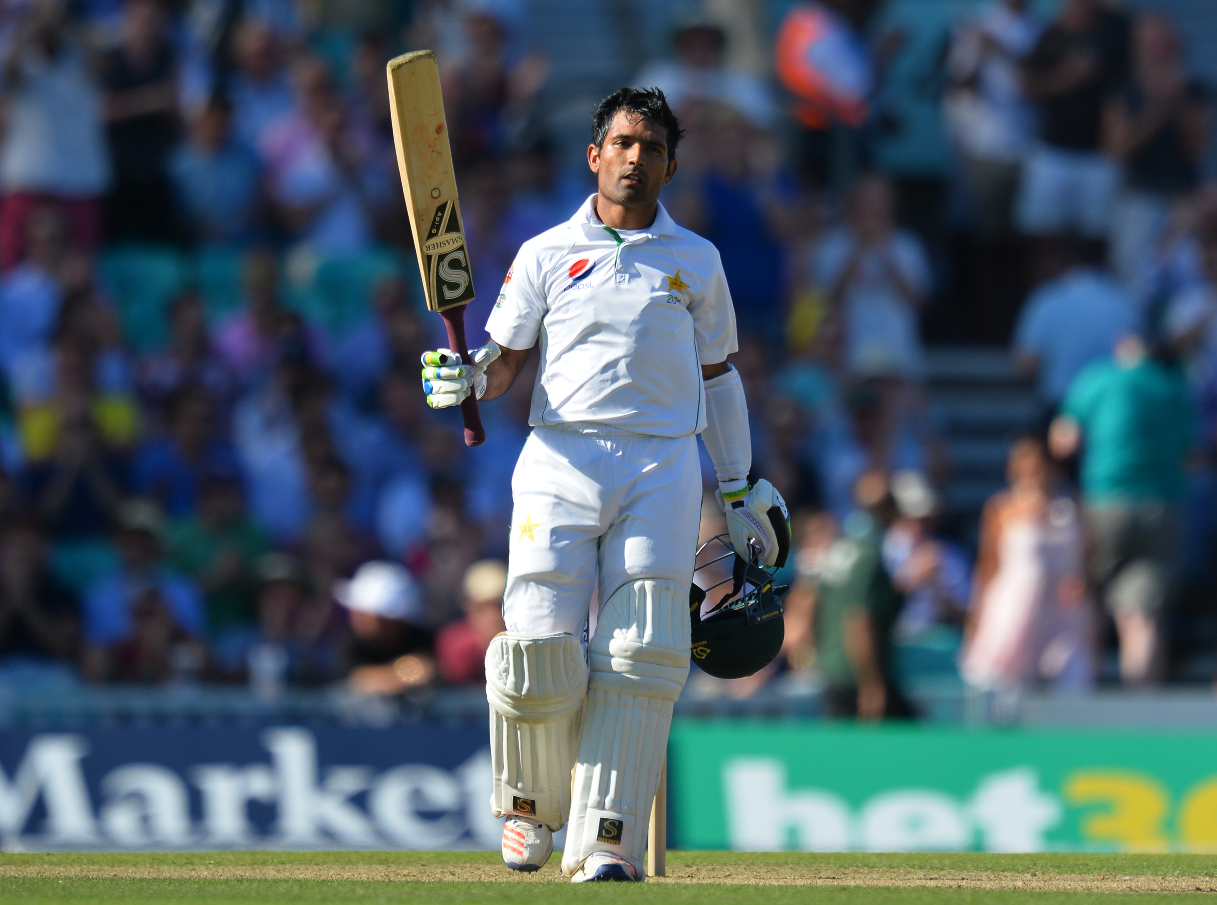 Pakistan's Asad Shafiq celebrates making a century (100 runs) on the second day of the fourth test cricket match between England and Pakistan at the Oval in London on August 12, 2016.   / AFP PHOTO / GLYN KIRK / RESTRICTED TO EDITORIAL USE. NO ASSOCIATION WITH DIRECT COMPETITOR OF SPONSOR, PARTNER, OR SUPPLIER OF THE ECB
