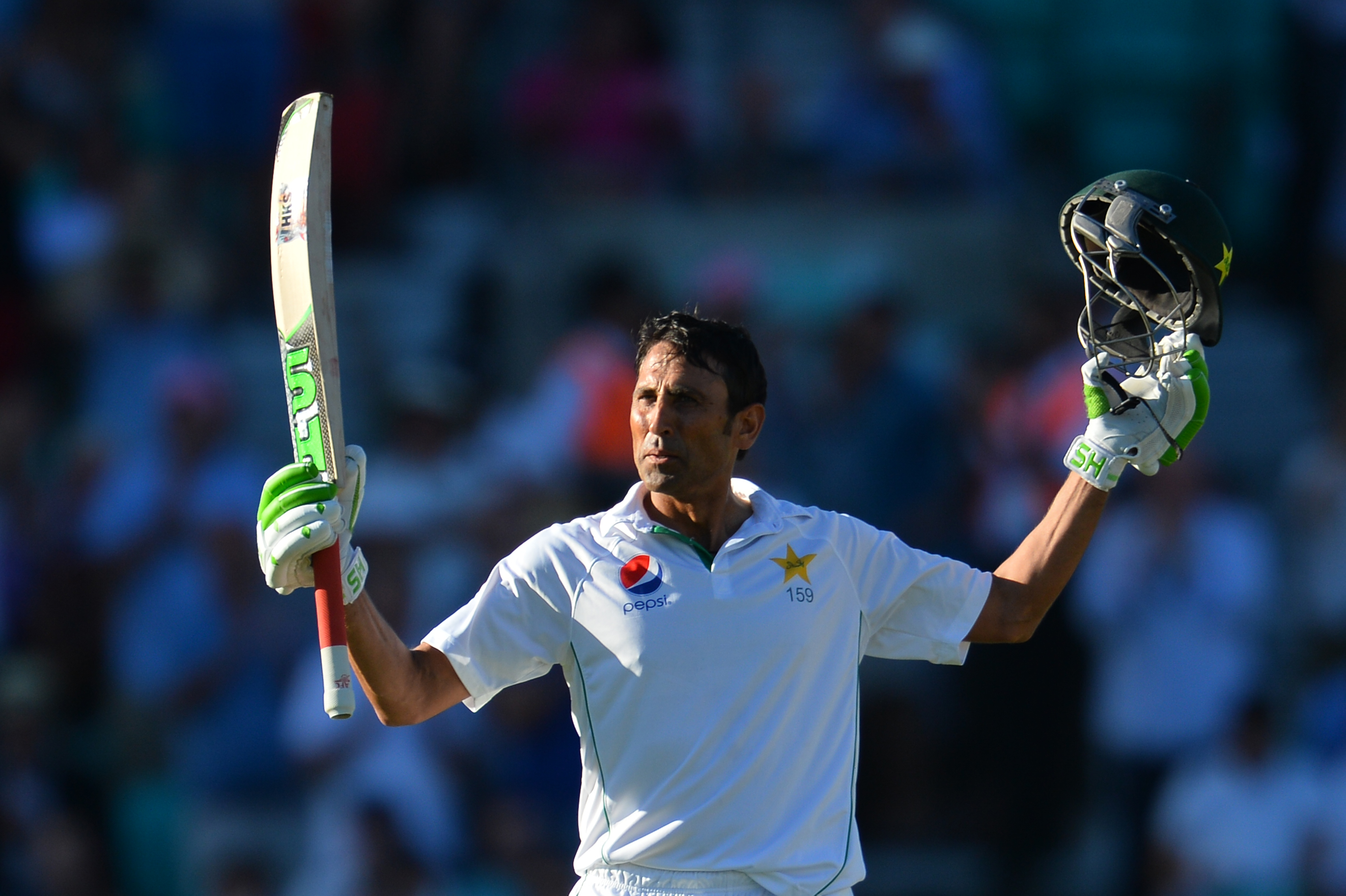 Pakistan's Younus Khan celebrates making a century (100 runs) on the second day of the fourth test cricket match between England and Pakistan at the Oval in London on August 12, 2016.   / AFP PHOTO / GLYN KIRK / RESTRICTED TO EDITORIAL USE. NO ASSOCIATION WITH DIRECT COMPETITOR OF SPONSOR, PARTNER, OR SUPPLIER OF THE ECB