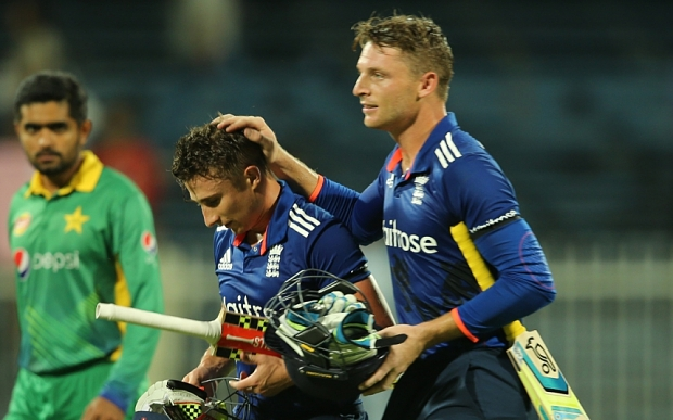 England's batsman James Taylor, second left, and Jose Buttler leave the pitch after the 3rd One Day Internationals between Pakistan and England at the Sharjah Cricket Stadium in Sharjah, United Arab Emirates, Tuesday, Nov. 17, 2015. (AP Photo/Kamran Jebreili)