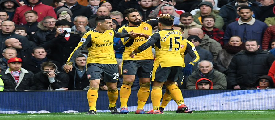 Giroud sucker-punch earns Arsenal draw at Man Utd