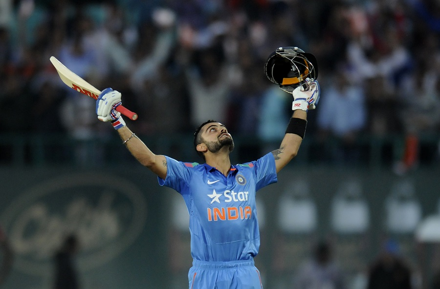 Virat Kholi of India celebrates after scoring a century during the 4th One Day International, ODI, between India and The West Indies held at the HPCA Stadium, Dharamsala, India on the 17th October 2014 Photo by:  Pal Pillai/ Sportzpics / BCCI