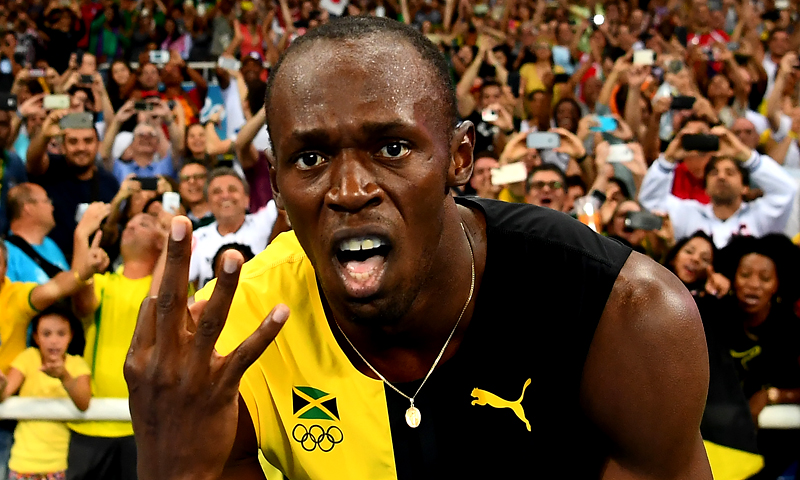 This file photo taken on August 20, 2016 shows Jamaica's Usain Bolt holding up three fingers for a third relay Olympic title after Team Jamaica won the Men's 4x100m Relay Final during the athletics event at the Rio 2016 Olympic Games at the Olympic Stadium in Rio de Janeiro.