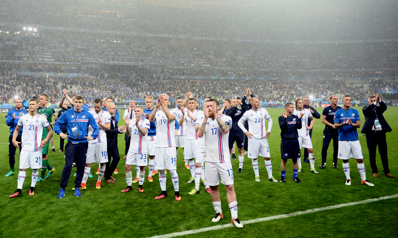 This file photo taken on July 3, 2016 shows Iceland's midfielder Aron Gunnarsson (C) and team mates acknowledging the fans after the Euro 2016 quarter-final football match between France and Iceland at the Stade de France in Saint-Denis, near Paris. (PHOTO: AFP)
