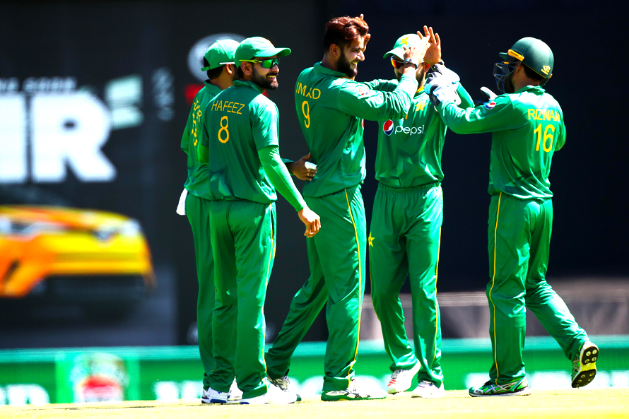Pakistan player's celebrate the wicket of Chris Lynn. (PHOTO: AFP)