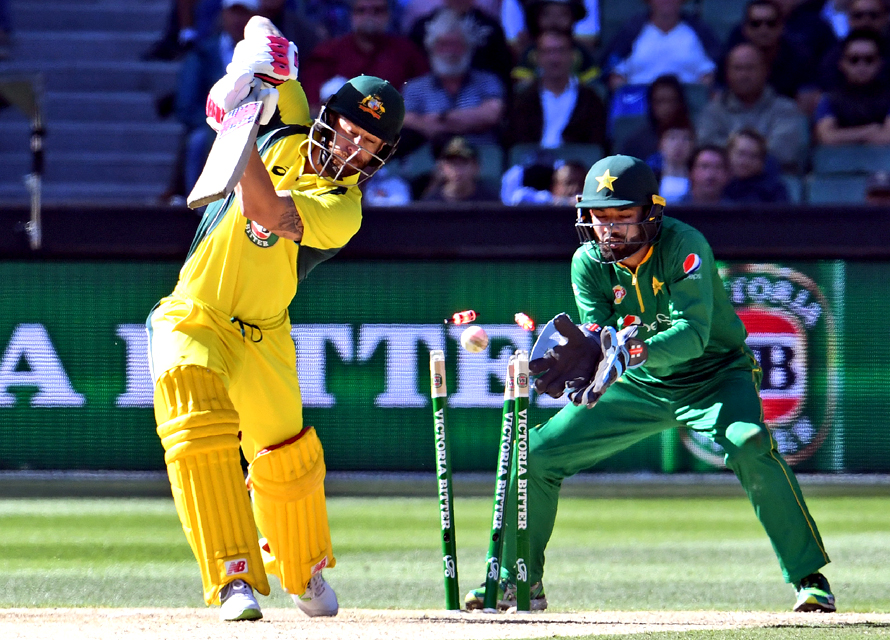 Australia's batsman Matthew Wade is bowled as Pakistan wicketkeeper Mohammad Rizwan looks on. (PHOTO: AFP)