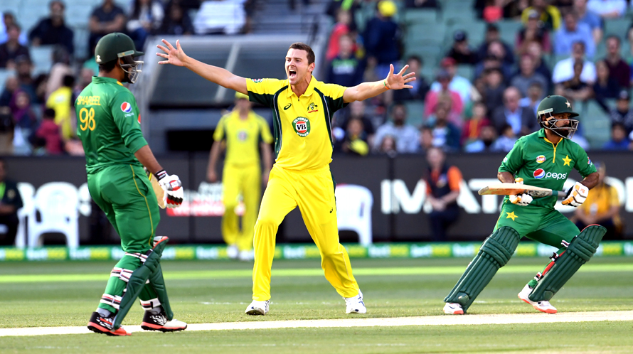 Australia's Josh Hazlewood appeals for an LBW decision against Pakistan batsman Mohammad Hafeez as fellow batsman Sharjeel Khan looks on. (PHOTO: AFP)