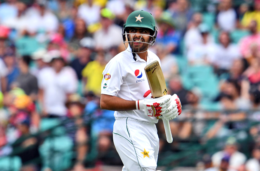 Pakistan batsman Babar Azam walks off after being dismissed by Australia's paceman Josh Hazlewood during the second day of the third cricket Test match at the SCG in Sydney on January 4, 2017. / AFP PHOTO / WILLIAM WEST / --IMAGE RESTRICTED TO EDITORIAL USE - STRICTLY NO COMMERCIAL USE--