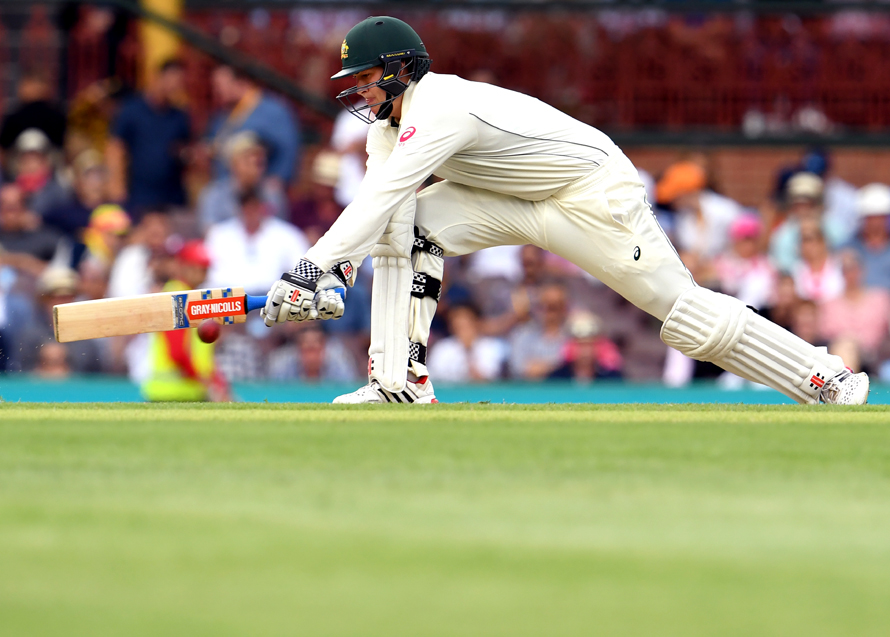 Australia's batsman Matt Renshaw plays a reverse sweep from the Pakistan bowling during the first day of the third cricket Test match at the SCG, in Sydney on January 3, 2017. / AFP PHOTO / WILLIAM WEST / IMAGE RESTRICTED TO EDITORIAL USE - STRICTLY NO COMMERCIAL USE