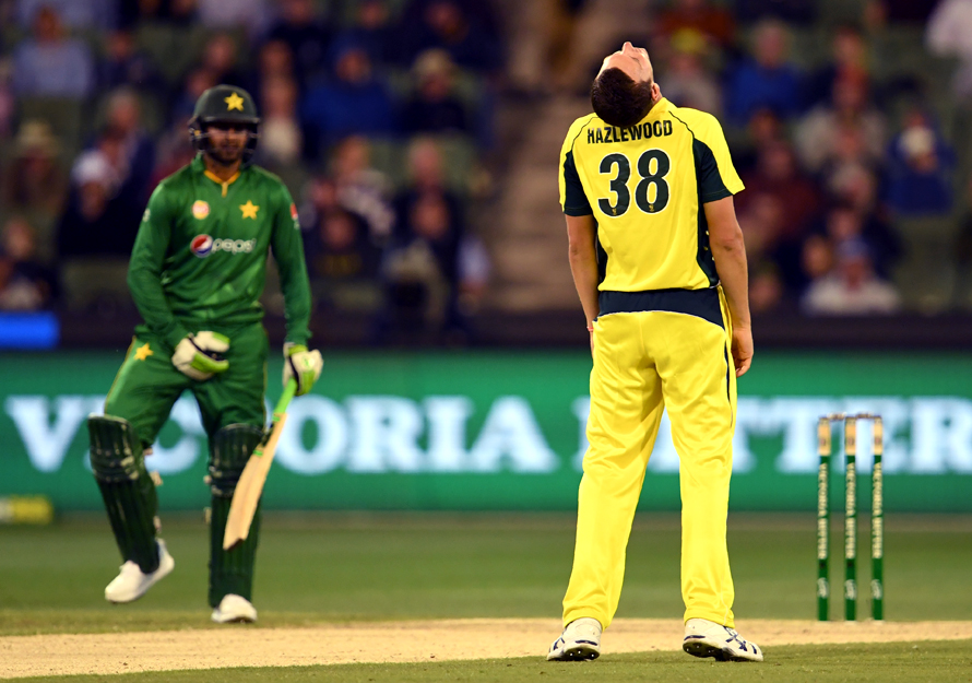 Australia's Josh Hazlewood reacts as Pakistan batsman Shoaib Malik looks on. (PHOTO: AFP)