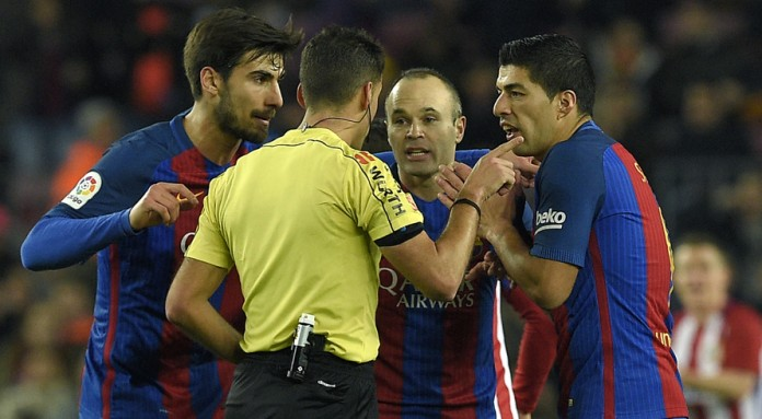 Suarez sent-off as Barca oust Atletico to reach final
