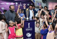 Shahid Afridi reaches Edhi Home with ICC Champions Trophy