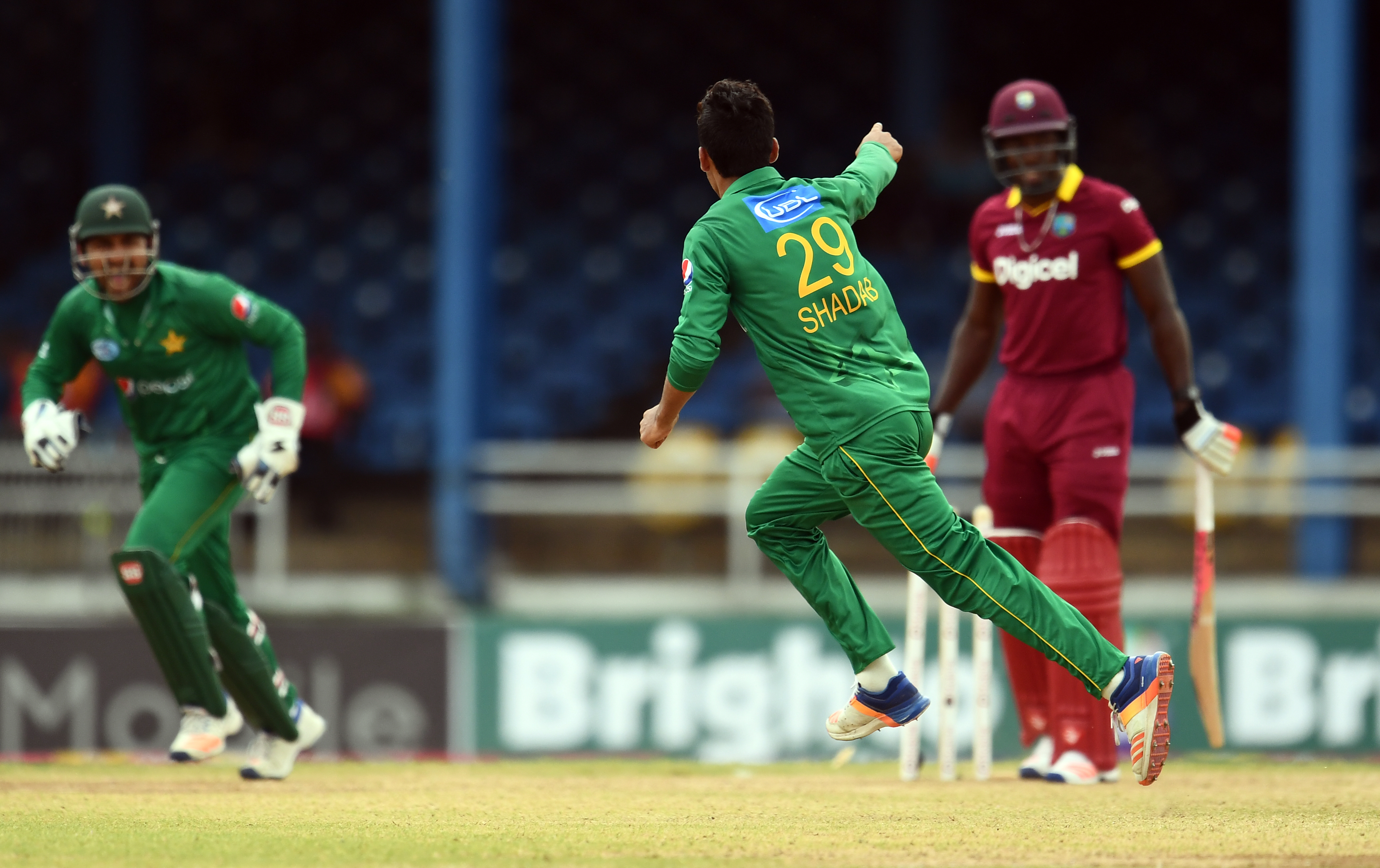 Pakistan's Shadab Khan (#29) celebrates after bowling out West Indies' Rovman Powell (R) during the second of four-T20I-match between West Indies and Pakistan at the Queen's Park Oval in Port of Spain, Trinidad, on March 30, 2017. / AFP PHOTO / Jewel SAMAD