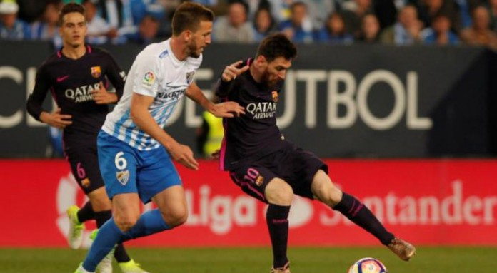 Barcelona fall to shock Malaga defeat after Madrid derby draw