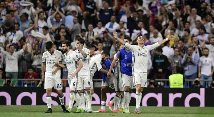 Ronaldo hat-trick fires Real into semis