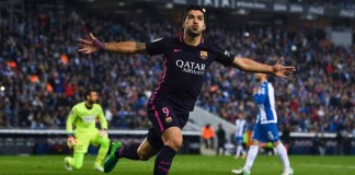 Suarez double keeps Barca level with Madrid