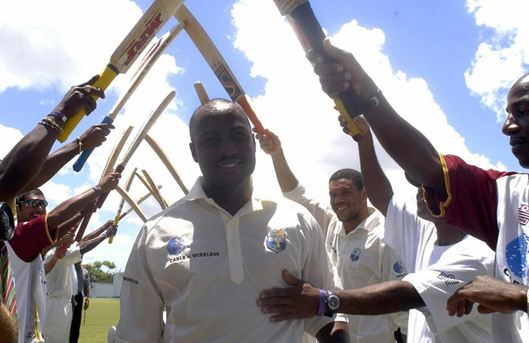West Indies' Brian Lara gets Guard of Honour from his teammates.