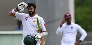 Ali century anchors cautious Pakistan to 376