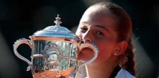 Ostapenko blasts back to claim stunning French title
